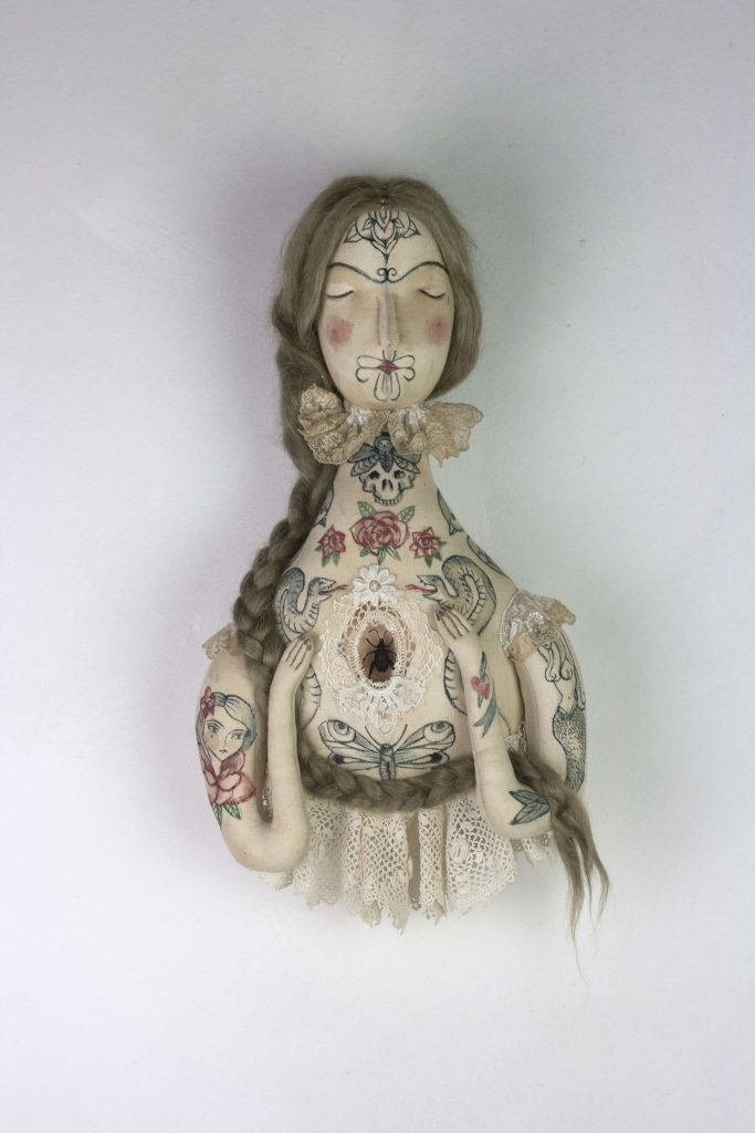 tattooed doll