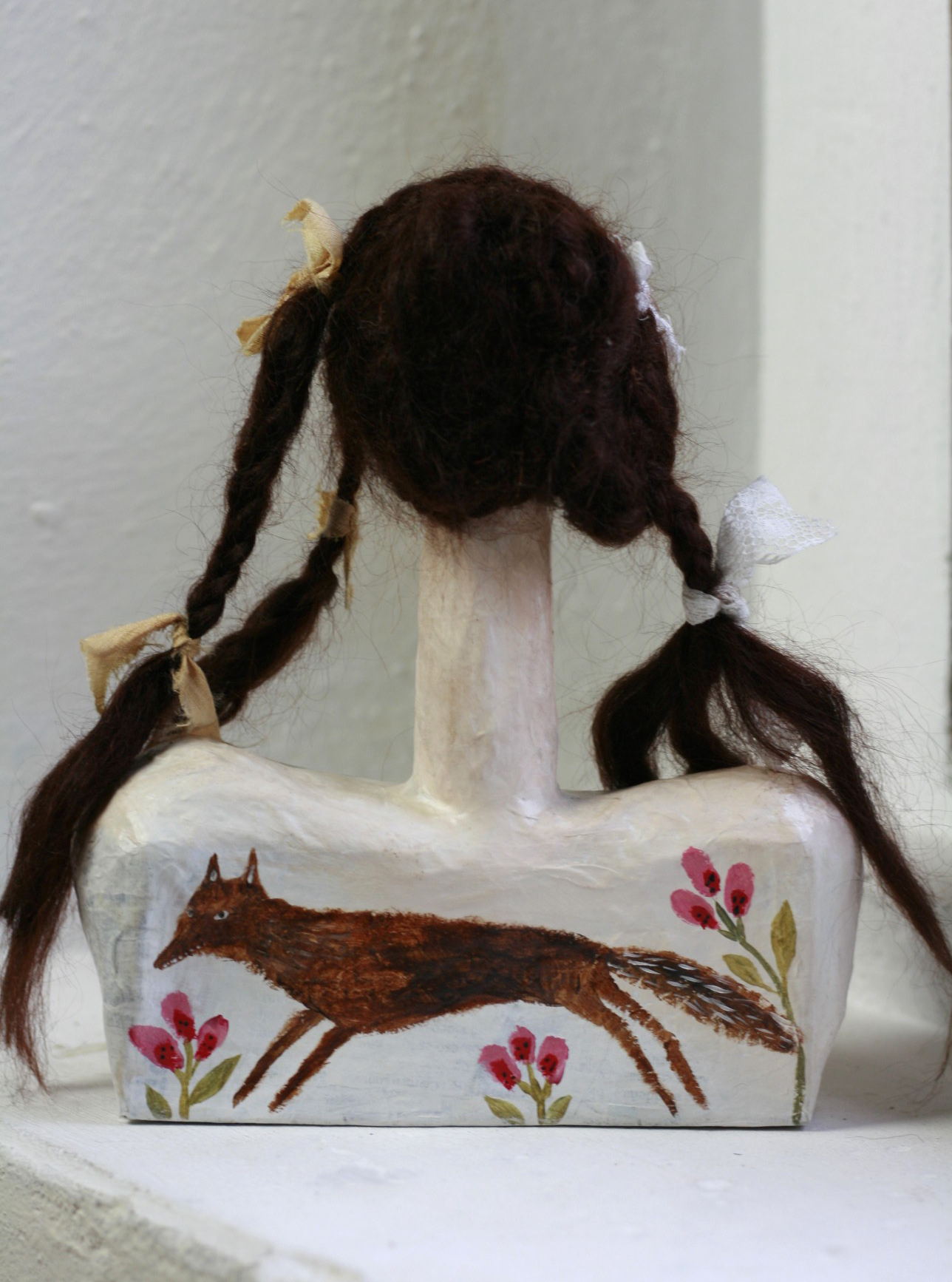 'Wolf Maiden' paper-maché doll