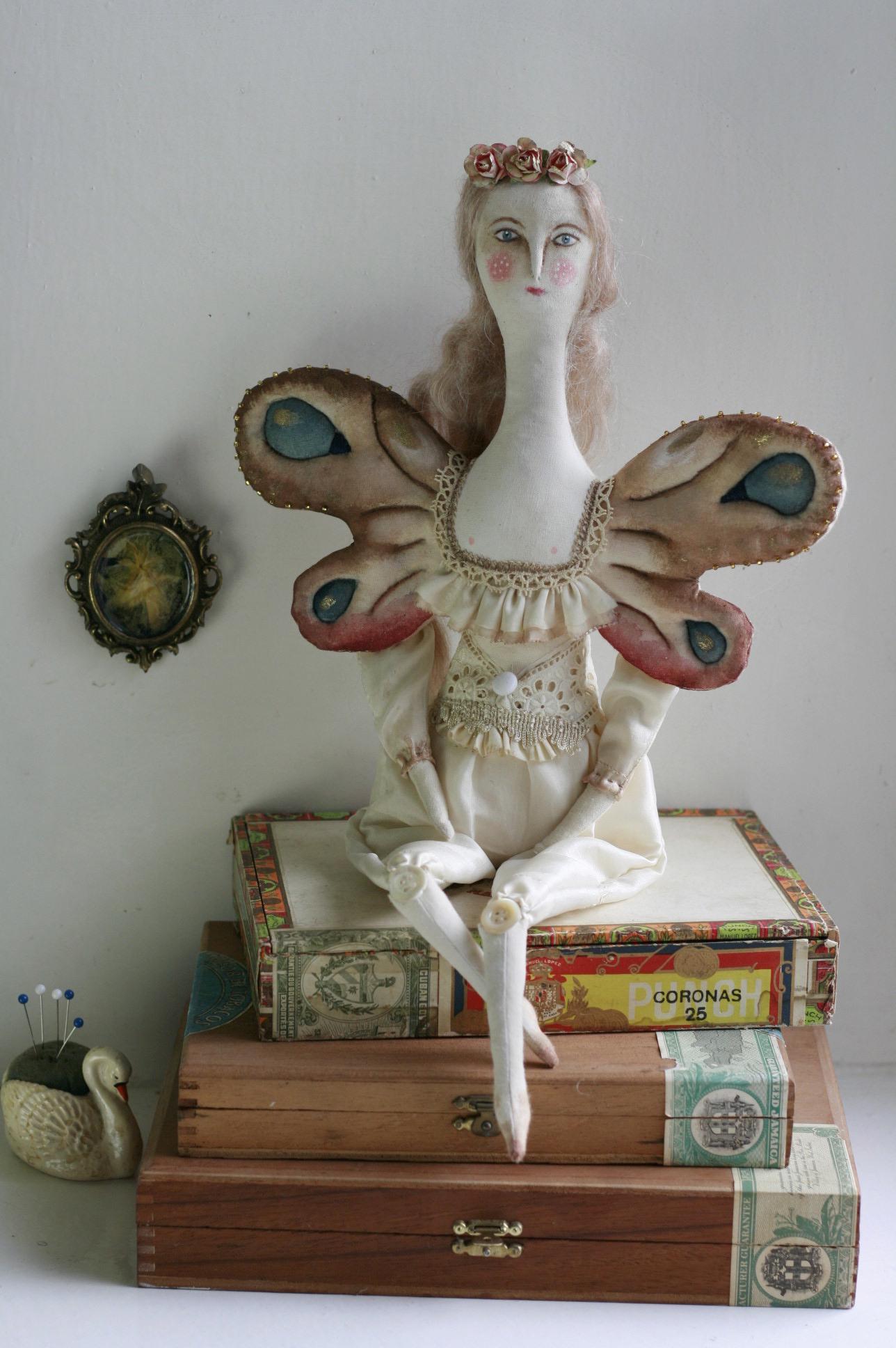 textile moth doll